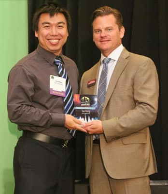 Photo Tao Hong with the Kevin Pitts, CBJ publisher