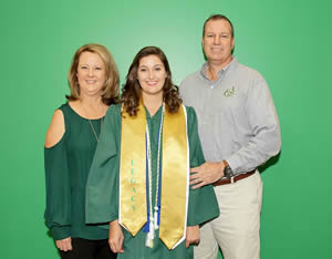 A legacy student with her parents
