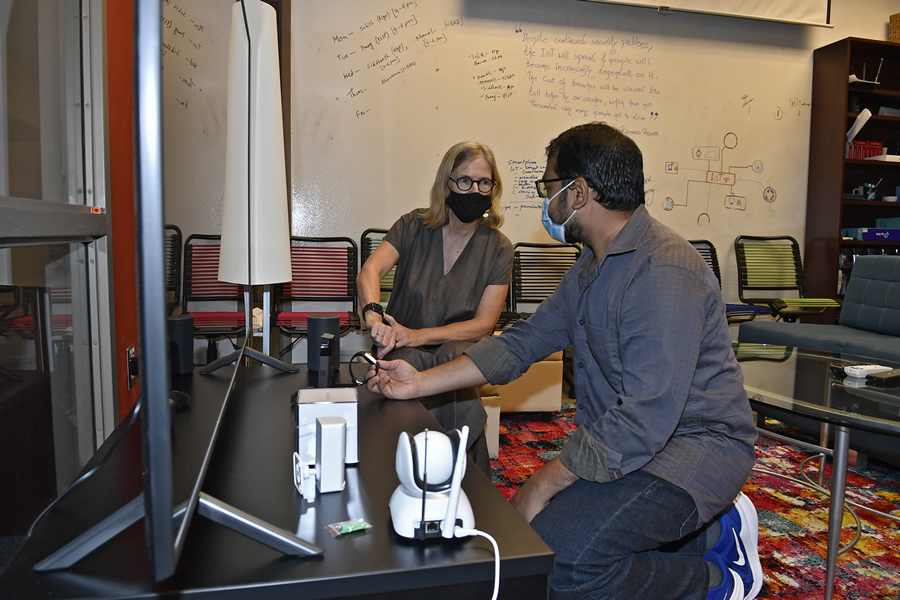 Mary Lou Maher, professor of software and information systems and director of the Integrated Critical Core and Center for Education Innovation, and Shaikh Islam, Ph.D. student in computing and information systems and software and information systems
