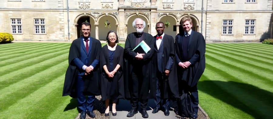 Akin Ogundiran, second right, was inducted as a Visiting Fellow of Magdalene College.