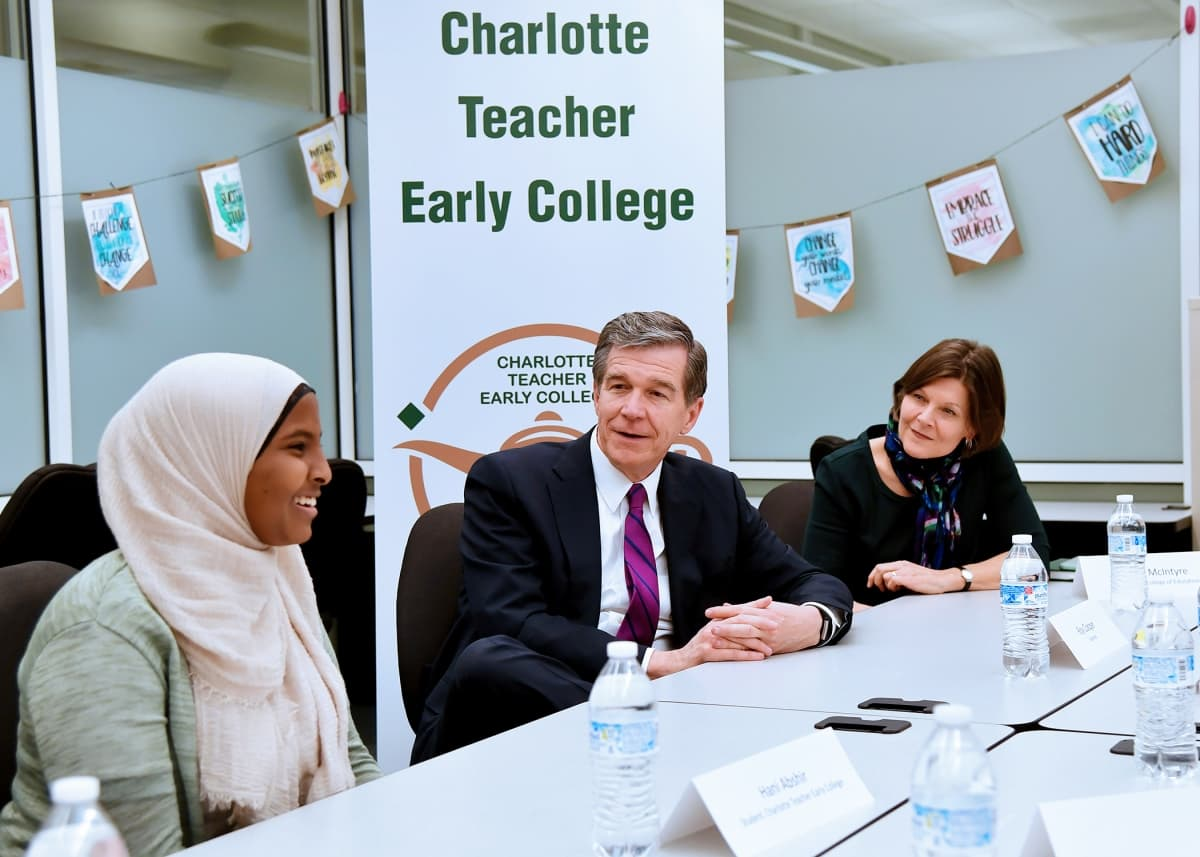 Gov. Roy Cooper led an education roundtable during a visit to campus.