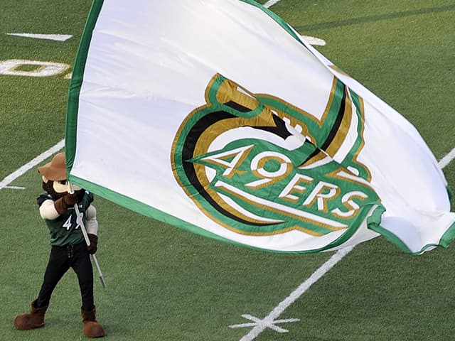 Norm with a Charlotte 49ers flag