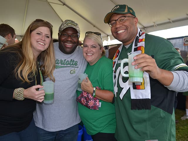 Alumni at Alumni Tailgate Village