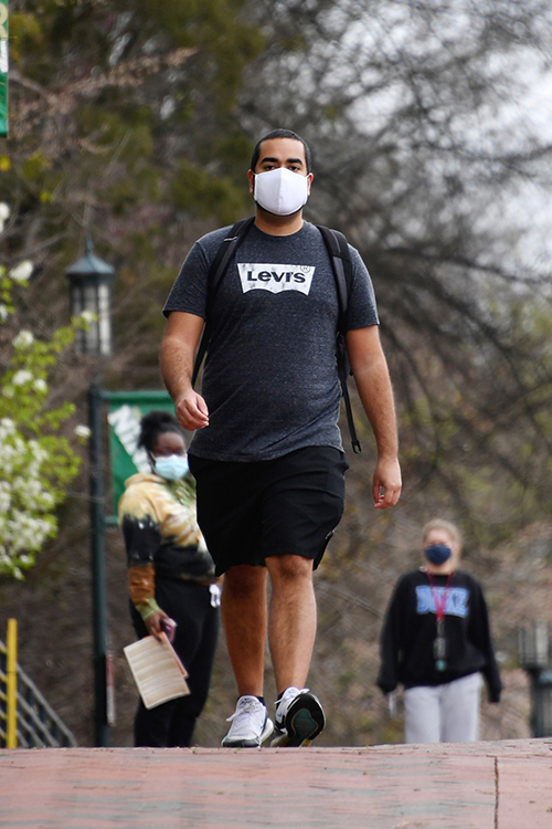 student walking on UNC Charlotte campus