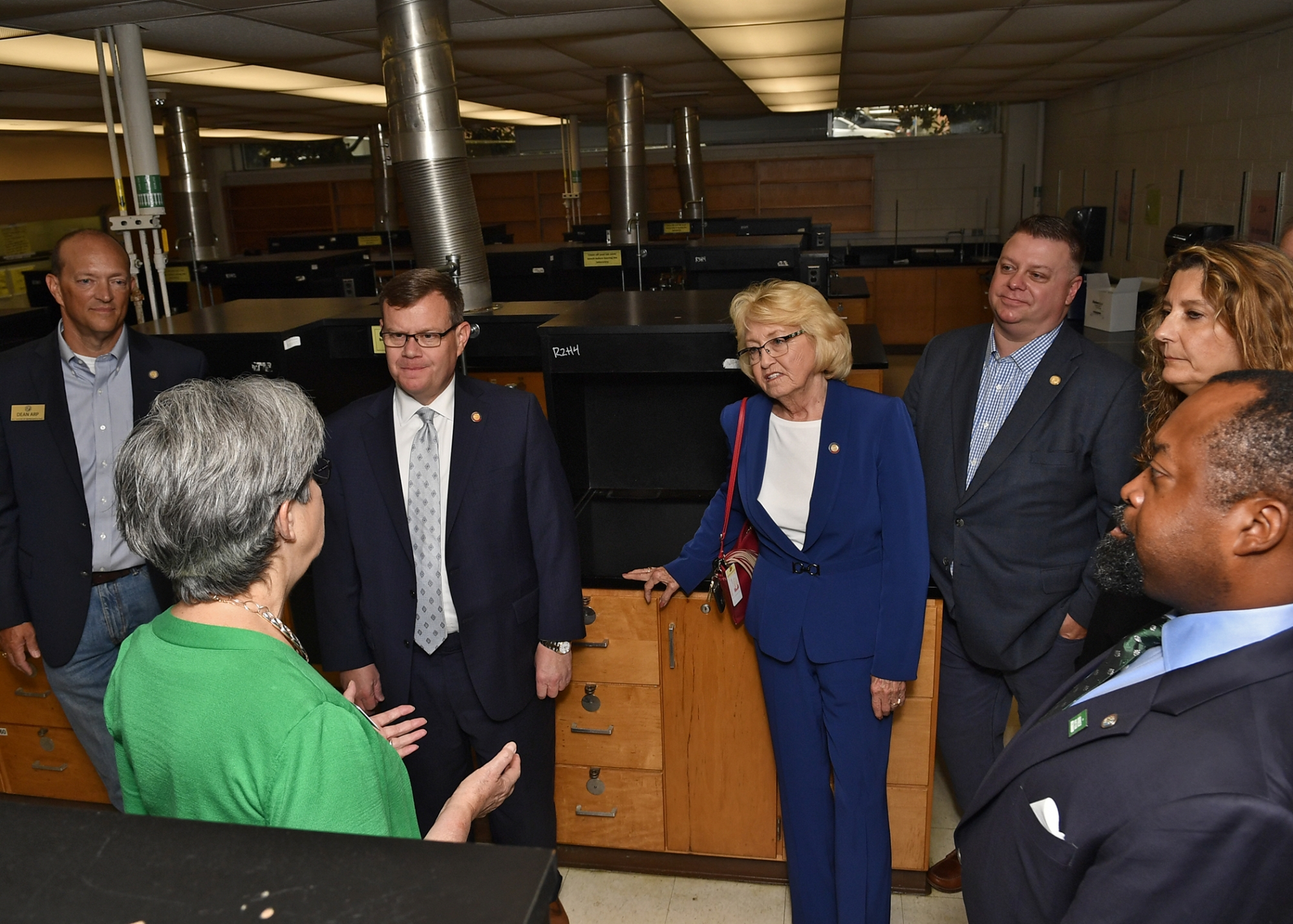 Provost Joan Lorden discusses pending renovations to the Burson and Cameron science buildings with North Carolina Representatives Dean Arp '99, House Speaker Tim Moore, Linda Johnson, Jason Saine '95, Chemistry Chair Bernadette Donovan-Merkert and UNC Charlotte Trustee Teross Young '93