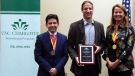 Scott Fitzgerald (center) accepts International Education Faculty Award